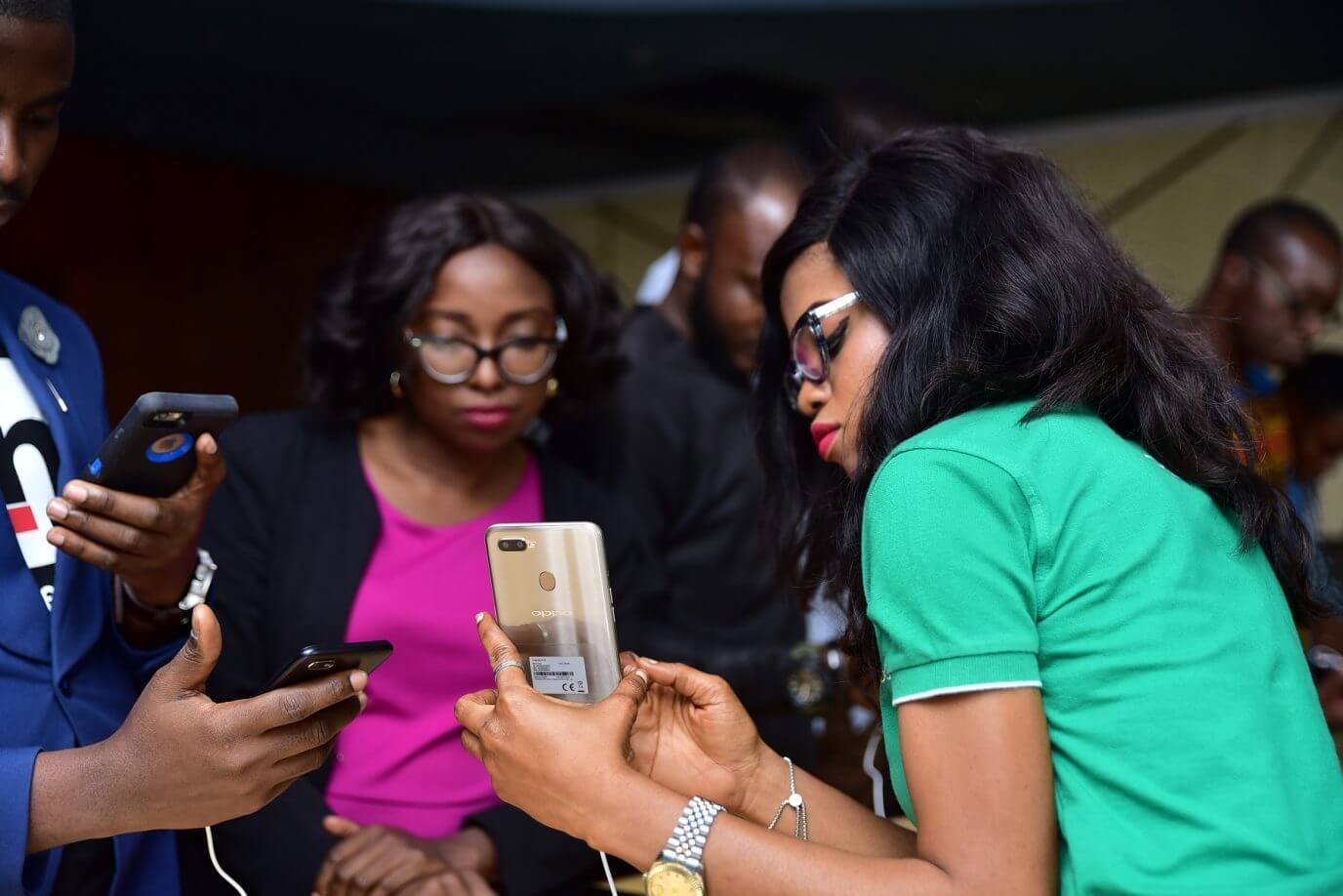 Guest examining the OPPO A1K and A5s at the launch today 2.